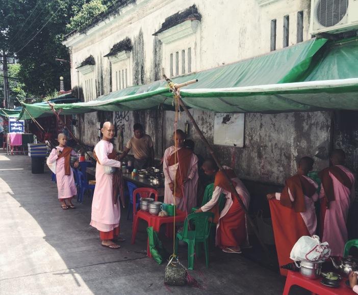 Young nuns preparing a meal in downtown Yangon, Myanmar